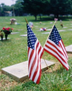 American flags at grave