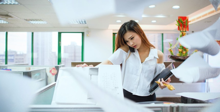 Woman busy and stressed at office