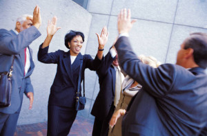 Happy Business People Giving High Fives