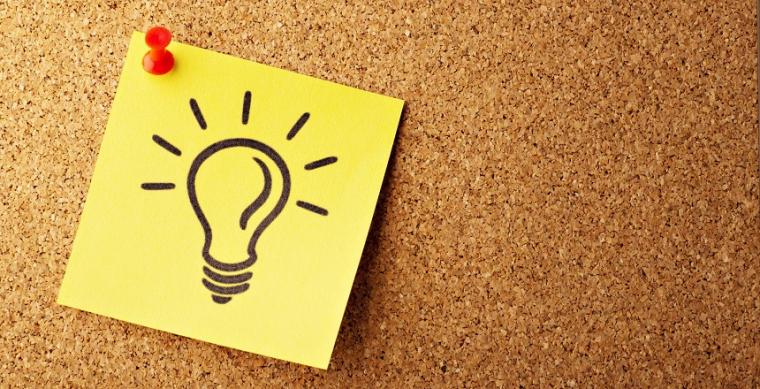 Picture of a light bulb on a cork board to represent bright idea