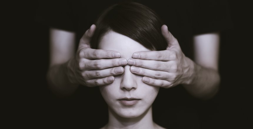 Woman with hands over eyes representing blind spot