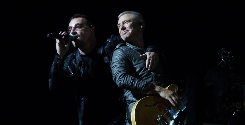 U2 in concert. Photo courtesy of Wikimedia user MelicansMatkin under Attribution-ShareAlike 3.0 Unported. Image has been cropped.