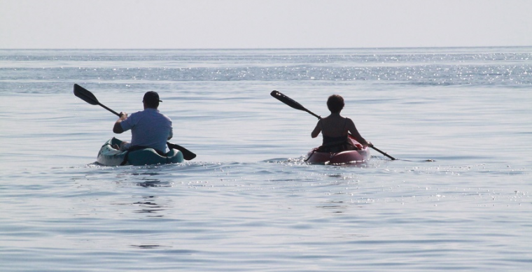 Connection during social distancing represented by two people in separate kayaks