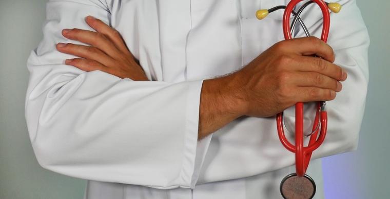 Doctor holding equipment