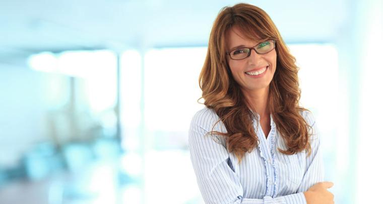 Happy female leader at work